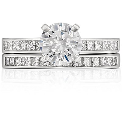Bague diamants sertis barrette taille princesse  en or blanc 14 carats