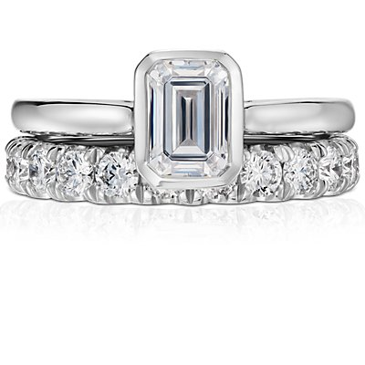 emerald cut bezel set solitaire engagement ring in