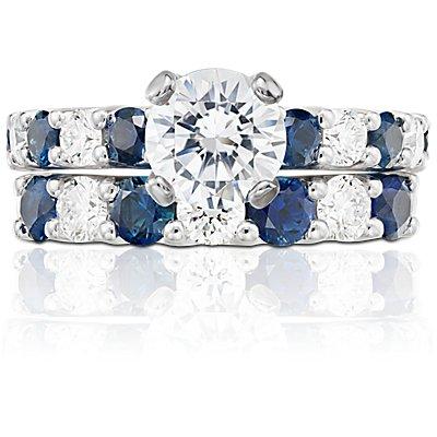 Anillo de diamantes y zafiros con siete piedras y garras en U en platino