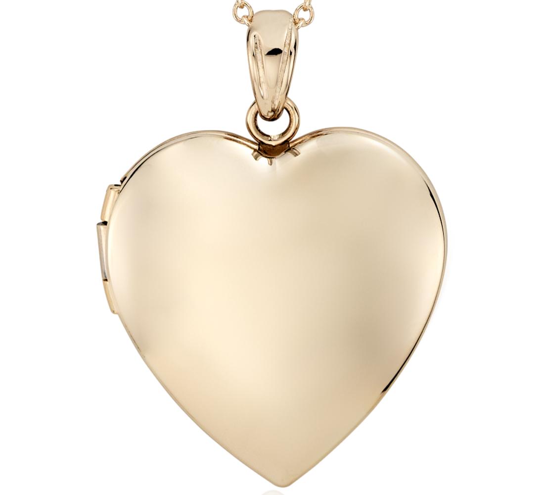 Relicario en forma de corazón en oro amarillo de 14k