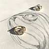 Sunlight illuminates the beauty of the ring atop one of Sarr's pencil sketches.