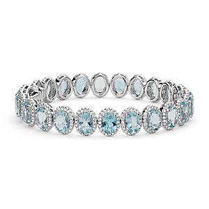 Brazalete de aguamarina ovalada y halo de diamantes en oro blanco de 18 k (7x5mm)