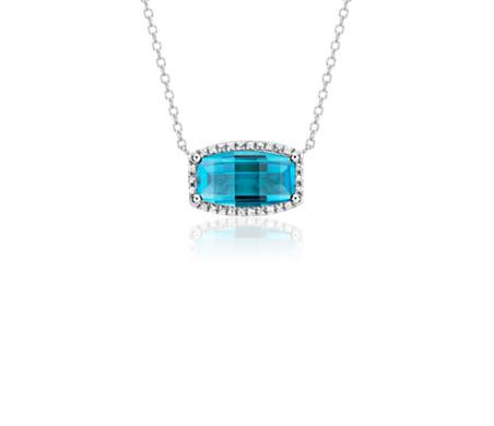 Colgante en forma rectangular con topacio azul suizo y halo de topacios blancos en plata de ley (12 x7 mm)