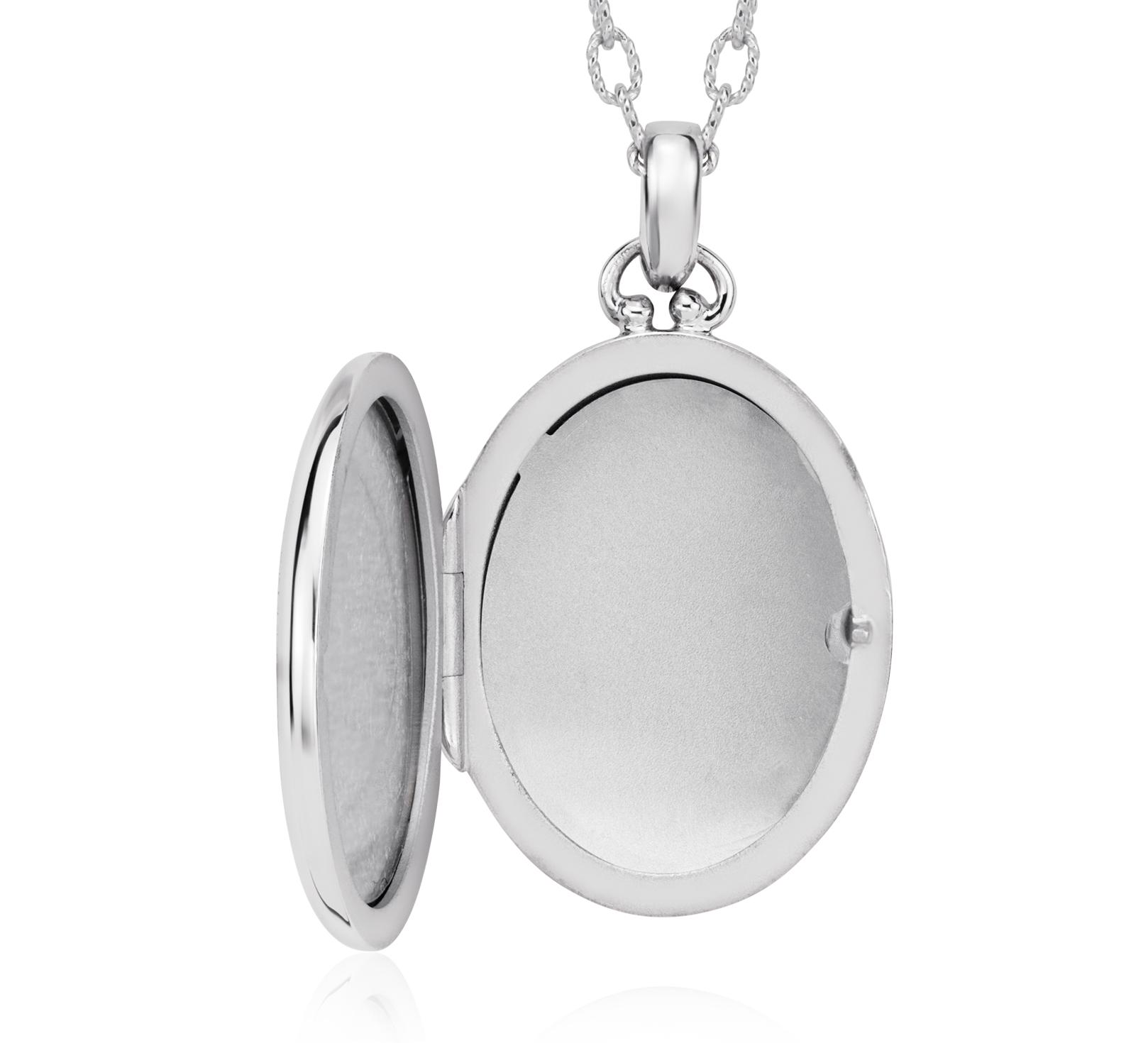 Médaillon ovale bordé de perles bijou de famille en argent sterling