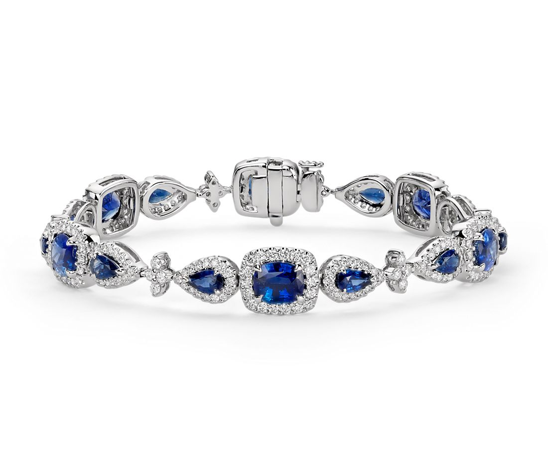 Cushion And Pear Shaped Blue Sapphire Diamond Halo