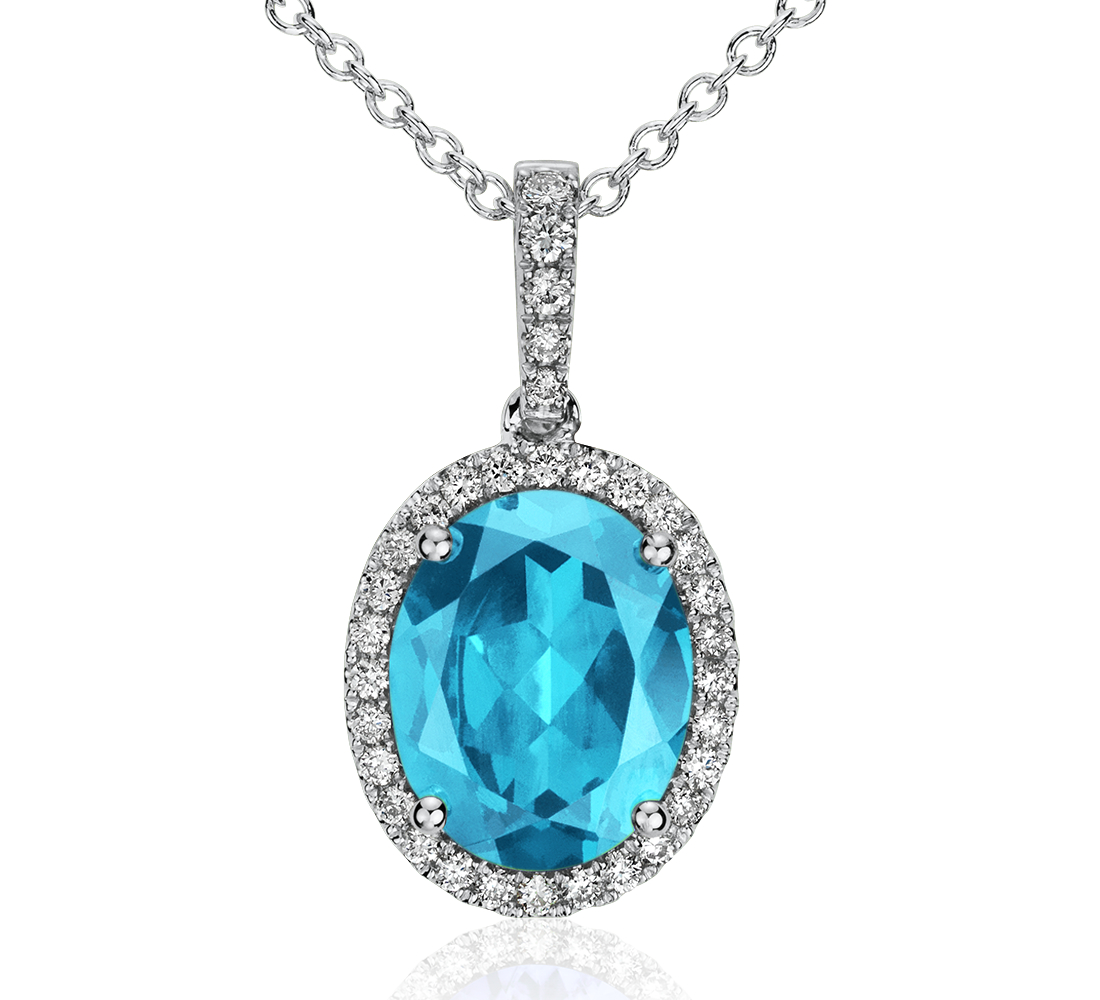 Colgante de diamante y topacio azul en oro blanco de 14 k (10x8mm)