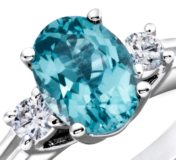 Anillo de diamantes y topacio azul en oro blanco de 18 k (8x6mm)