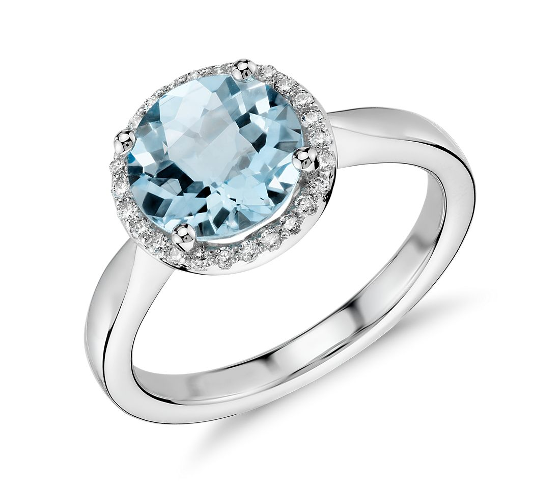 blue topaz and halo ring in 14k white gold