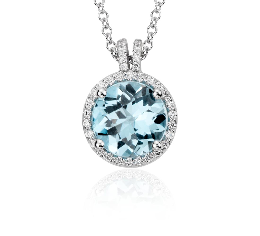 Petit pendentif halo de diamants et topaze bleue en  en or blanc 14carats (8mm)