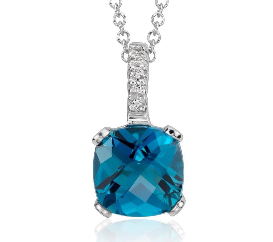 Pendentif fleur diamants et topaze bleu de Londres en or blanc 14carats