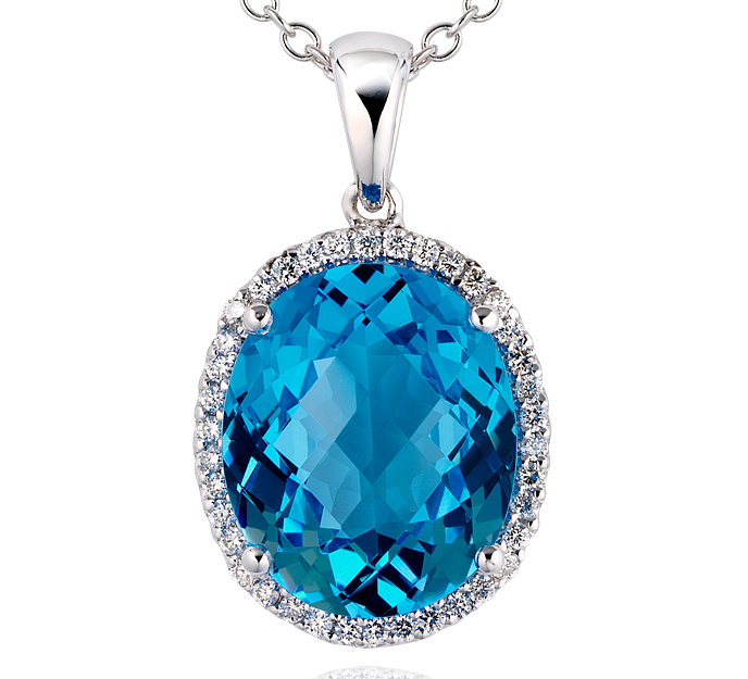 Pendentif diamant et topaze bleue en or blanc 18carats