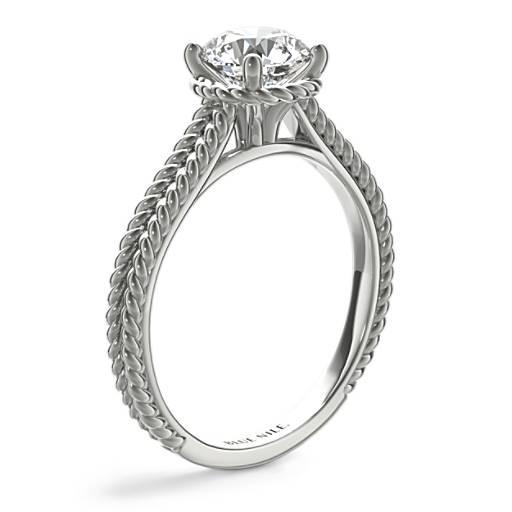 Bague de fiançailles diamant solitaire avec halo tressé