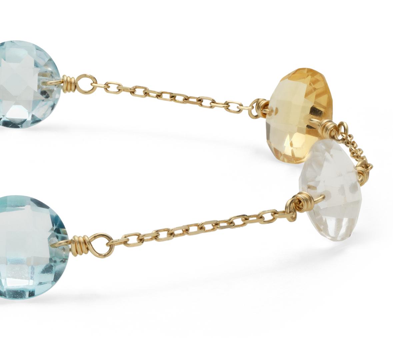 Brazalete con múltiples gemas en oro amarillo de 14k