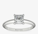 Classic Four Prong Solitaire Engagement Ring