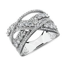 NUEVO. Anillo moderno con perfil cruzado de diamantes , en oro blanco de 14 k (11/2qt.total)