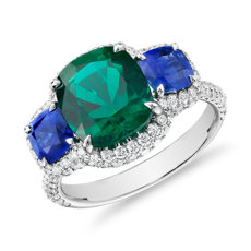 Cushion-Cut Emerald Ring with Sapphire Sidestones and Diamond Halo in 18k White Gold (3.47 ct. center)