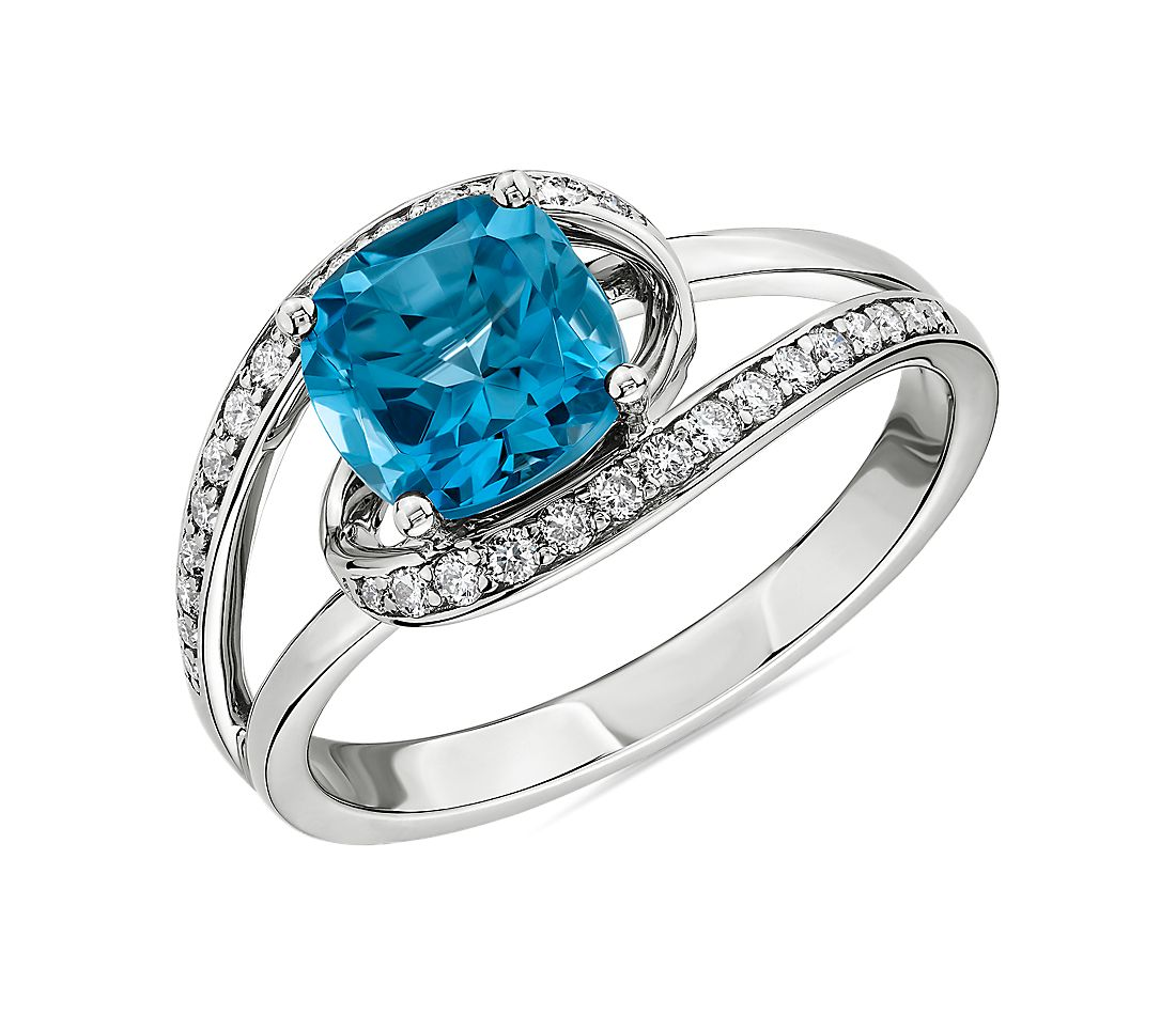 Cushion Cut Swiss Blue Topaz Ring with Twisting Halo in 14k White Gold