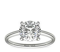 Petite Solitaire Engagement Ring in Platinum