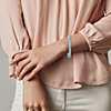 Closeup view of a bracelet worn on a woman's wrist