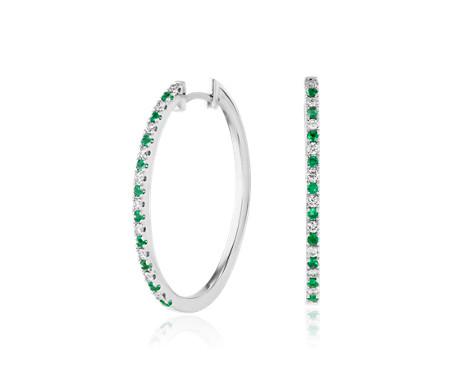 Aretes tipo argolla ovalados de diamantes y esmeraldas  en oro blanco de 14 k