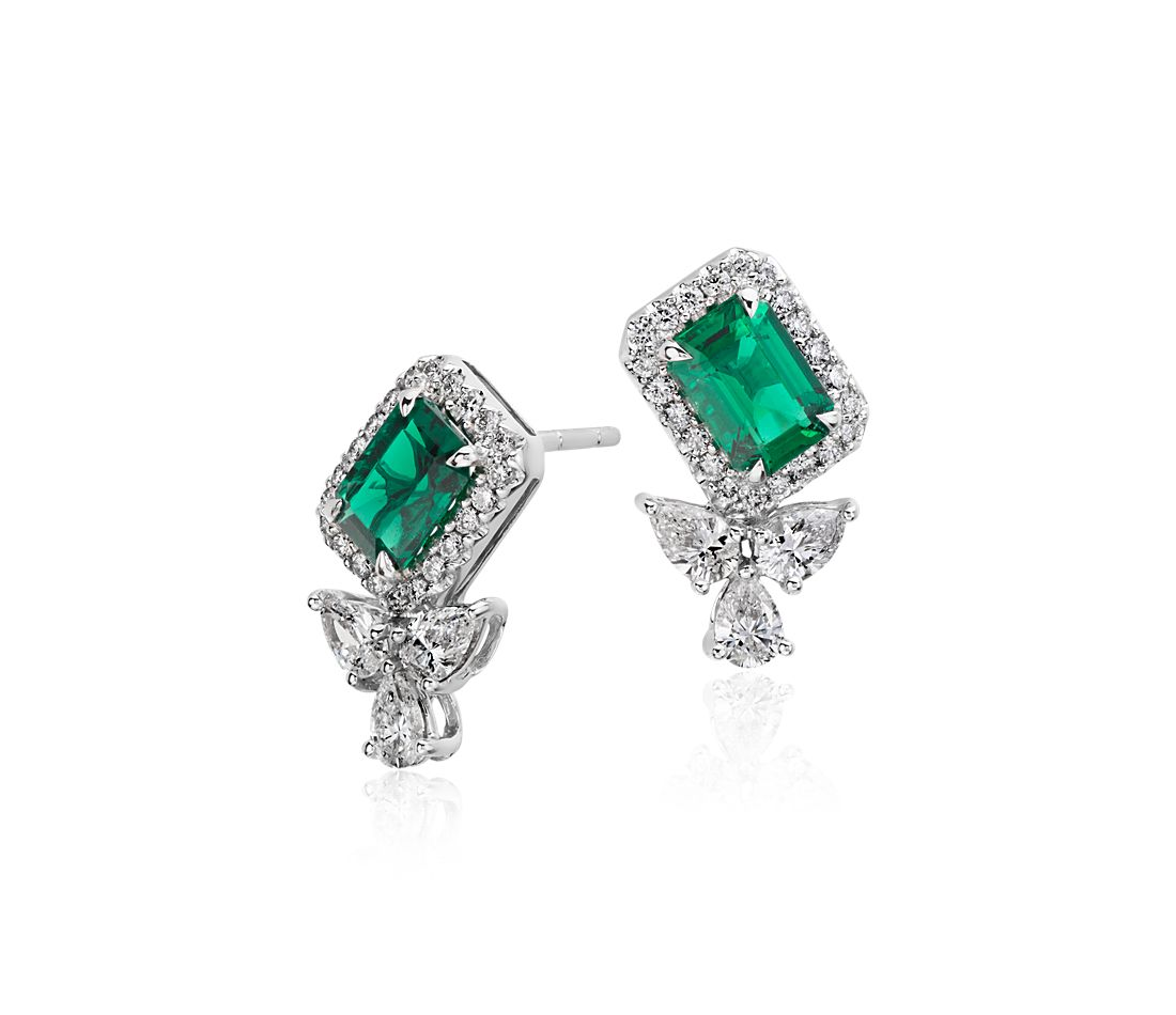 Emerald And Diamond Halo Stud Earrings In 18k White Gold 7x5mm