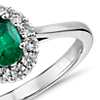 Emerald and Diamond Halo Ring in 14k White Gold (6x4mm)