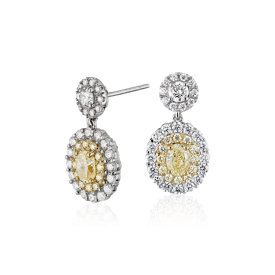 Fancy Yellow Diamond Halo Earrings in 18k White and Yellow Gold (3.15 ct. tw.)