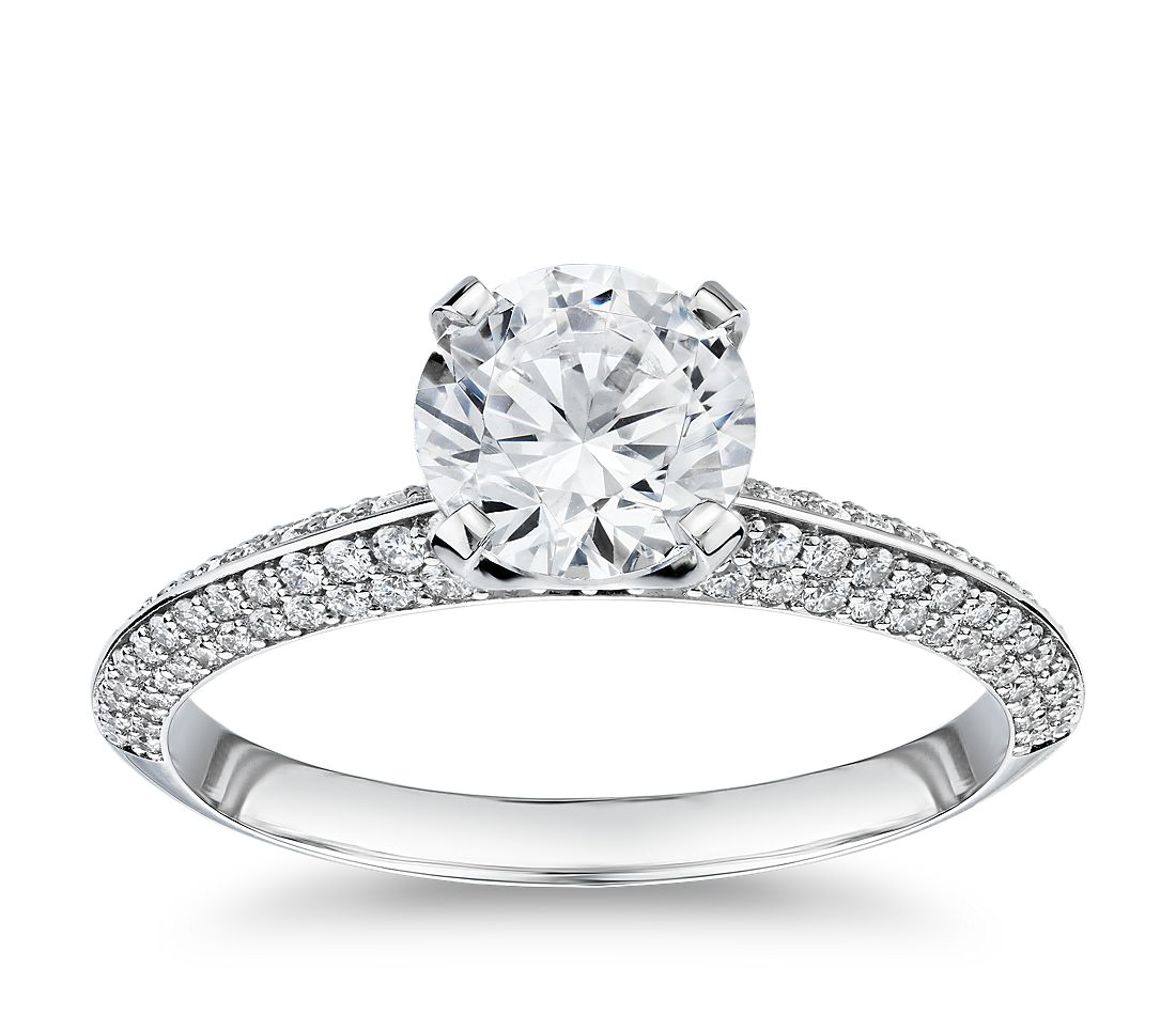 An engagement ring with a single 1-carat diamond and a knife-edge band with rows of micro pavé diamonds.
