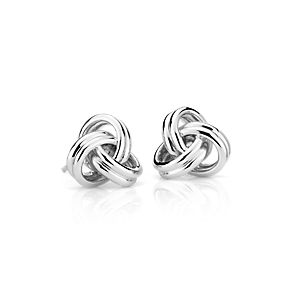 Sterling silver links intertwine to form open, airy love knots.