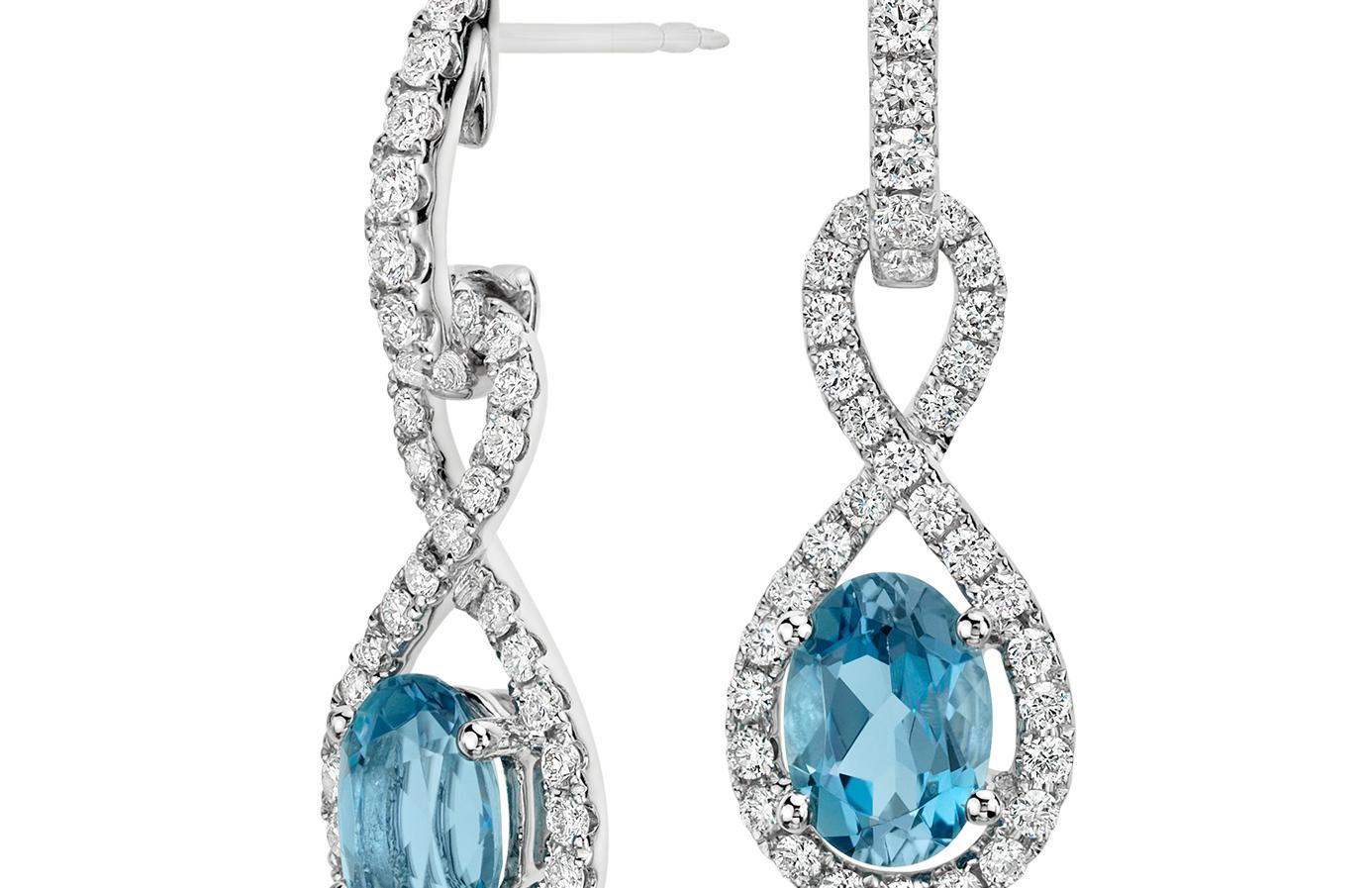 Boucles d'oreilles torsadées Infinity diamant et aigue-marine en or blanc 18carats (7x5mm)