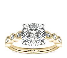 Bague de fiançailles diamant marquise millegrain et pois en or jaune 14carats