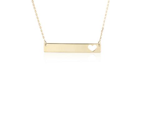 Collar de barra horizontal pequeña con silueta de corazón en oro amarillo de 14k