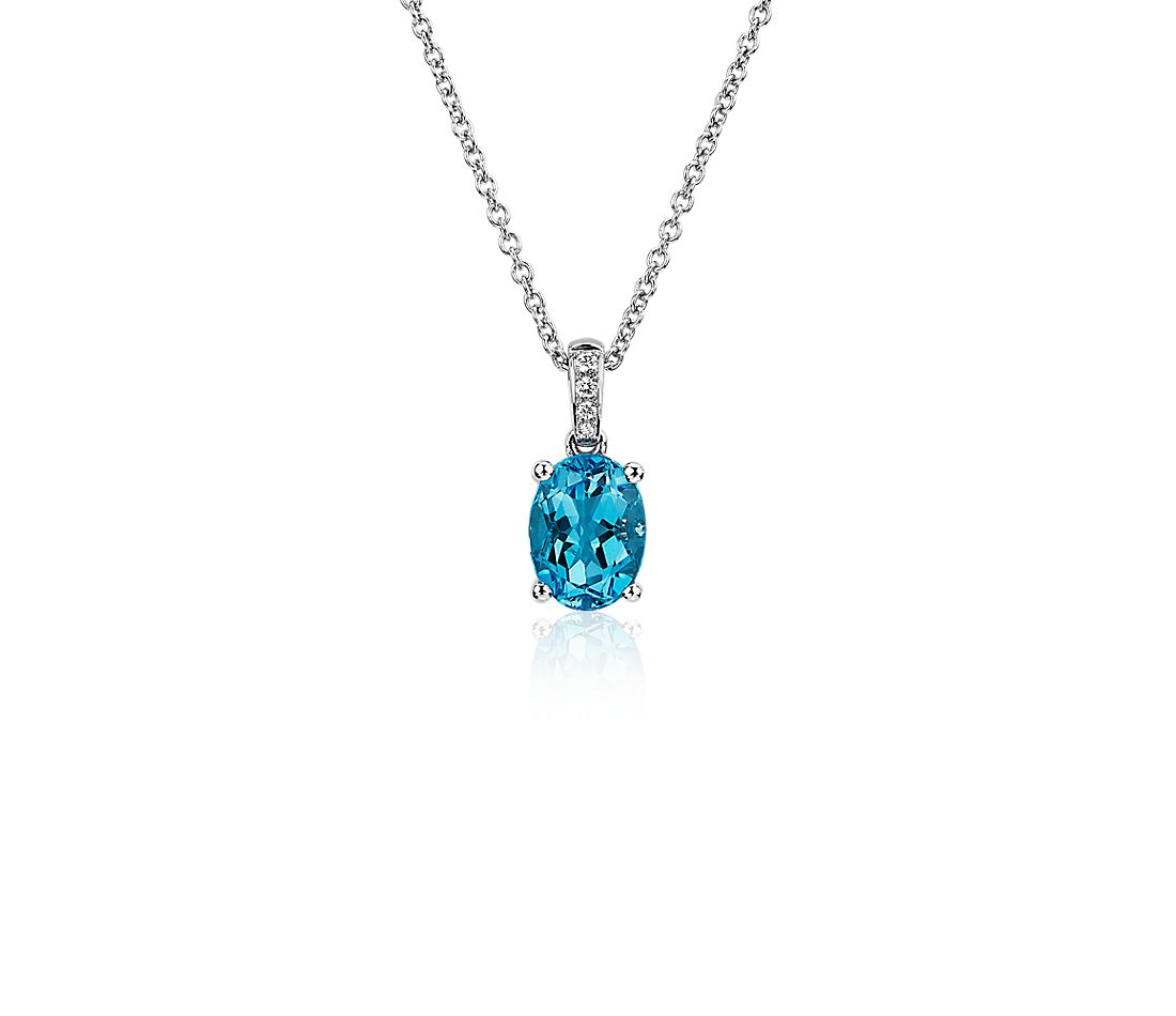 Oval Blue Topaz and Diamond Pendant in 14k White Gold (8x6mm)