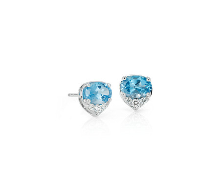 Oval Blue Topaz and Diamond Stud Earrings in 14k White Gold (7x5 mm)