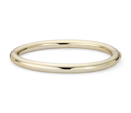 a solid yellow bangle shape gold hinged bracelet oval concealed with clasp bangles