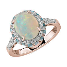 Oval Opal and Swiss Blue Topaz Halo Ring in 14k Rose Gold