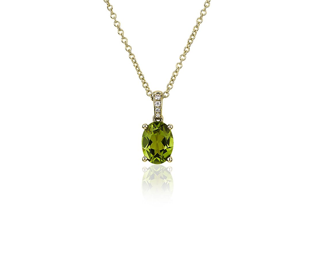 Oval Peridot and Diamond Pendant in 14k Yellow Gold (8x6mm)