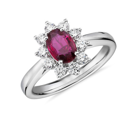 Oval Ruby and Diamond Starburst Halo Ring in 14k White Gold (7x5mm)