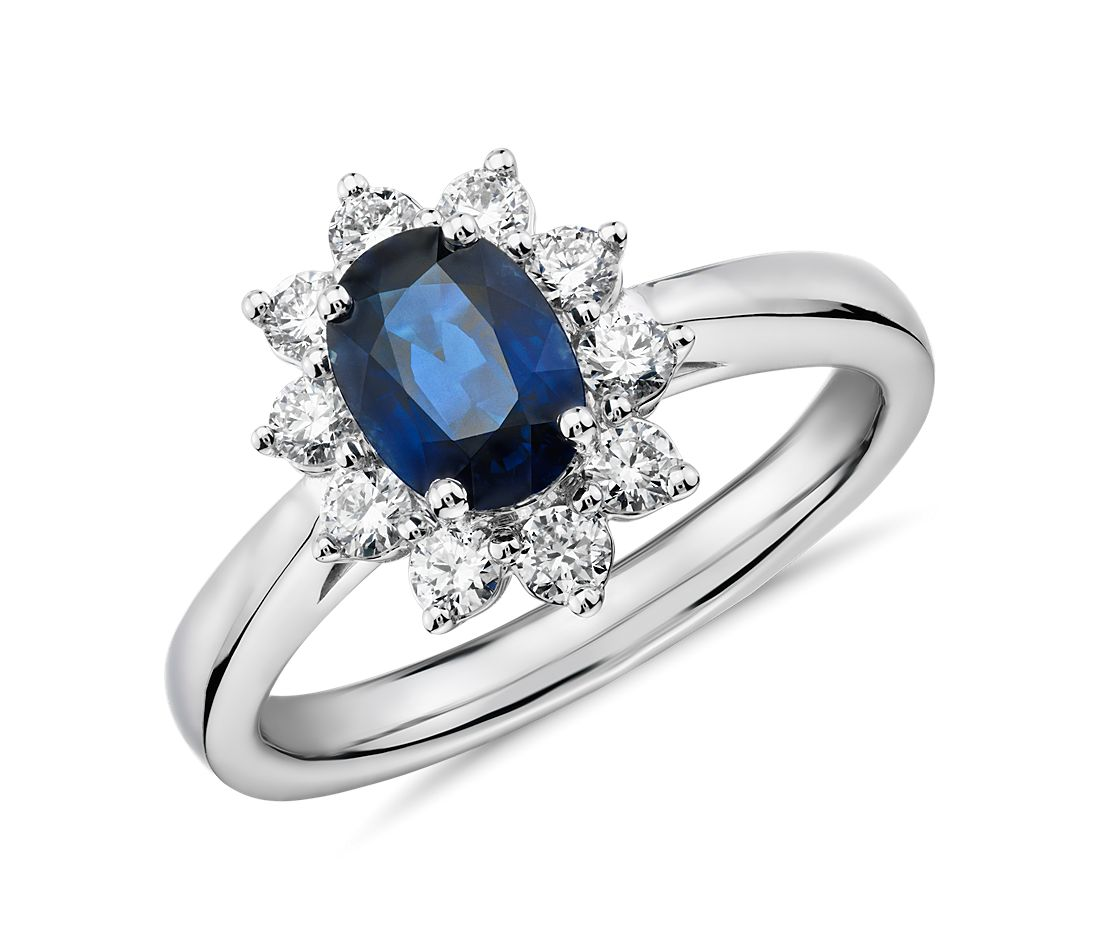 Oval Sapphire and Diamond Starburst Halo Ring in 14k White Gold (7x5mm)