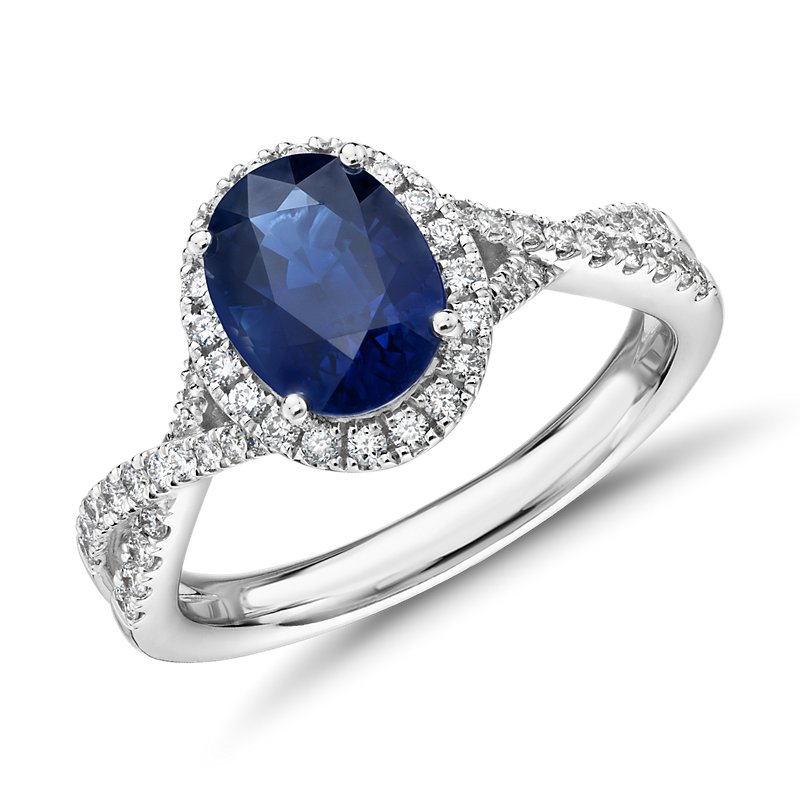 Oval Sapphire and Diamond Halo Twist Ring in 14k White Gold (8x6mm)