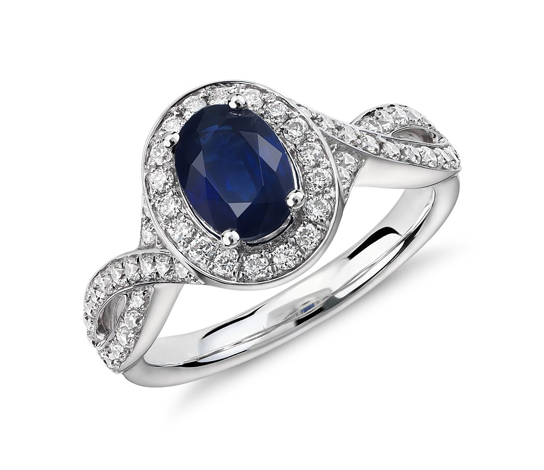 Bague torsadée saphir et halo de diamants en or blanc 14 carats