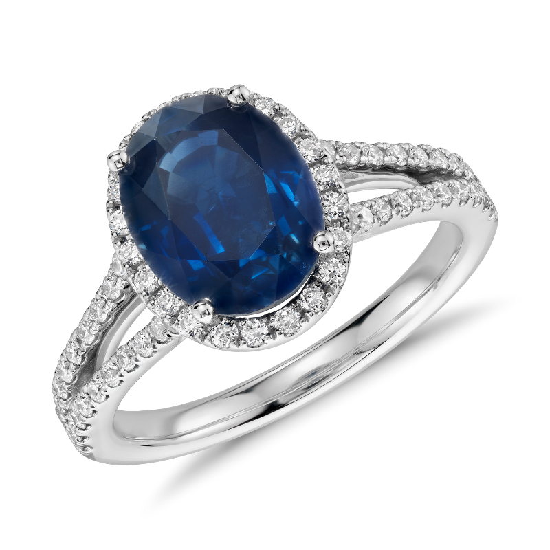Oval Sapphire and Diamond Halo Split Shank Ring in 18k White Gold