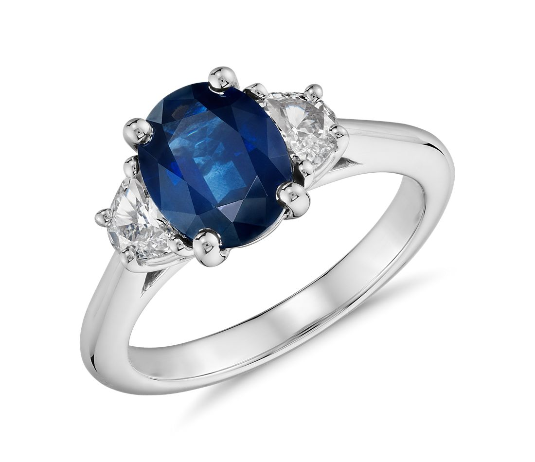 sapphire and halfmoon shaped diamond ring in platinum