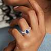 14k 白金带星状光环椭圆形蓝宝石戒指<br>(7x5毫米)