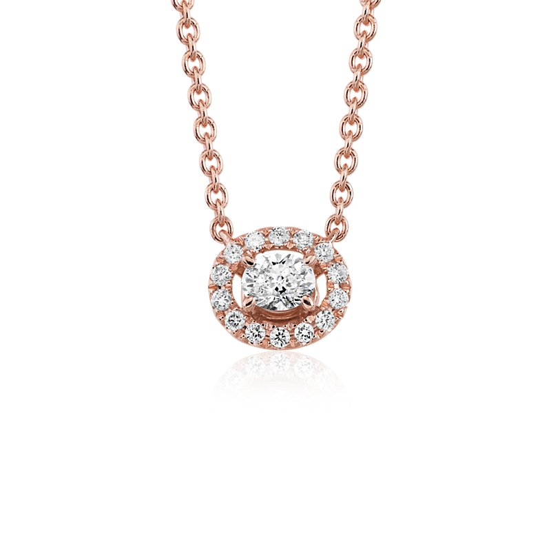 Oval Shape Diamond Halo Pendant in 14k Rose Gold (1/6 ct. tw.)