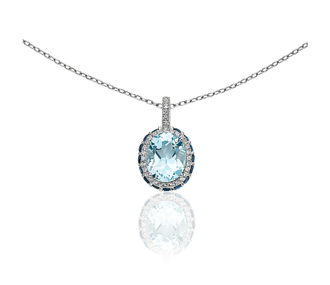 Oval Sky Blue Topaz Pendant with London Blue and White Topaz Halo in Sterling Silver
