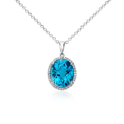 Swiss Blue Topaz And White Sapphire Halo Oval Pendant In