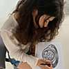 The artist at work on an illustration of her ring design for Ten/Ten.
