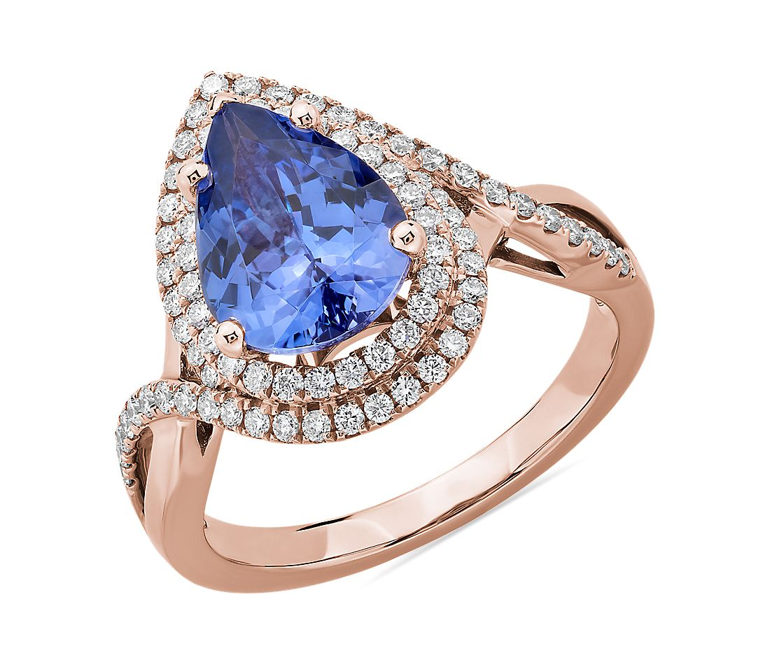 Bague tanzanite taille poire avec double halo de diamants en or rose 14 carats