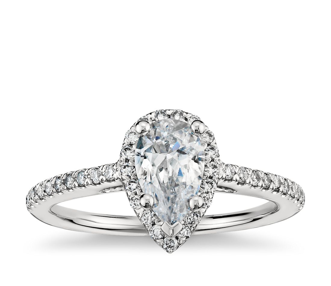 Pear shaped halo diamond engagement ring in platinum for Wedding bands for pear shaped rings